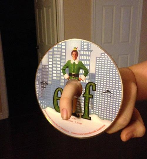 Elf DVD Finger Through Hole Penis ~ 25 Funny, Creepy Family Christmas Photos