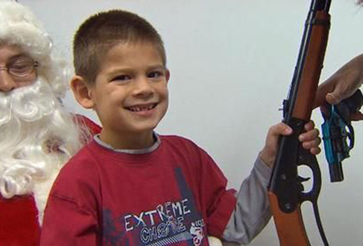 Kid With Gun Sitting on Santa's Lap ~ 25 Funny, Creepy Family Christmas Photos