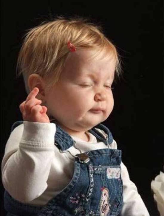 Whatever, Baby ~ 16 Funny Family Photoss ~ giving the finger