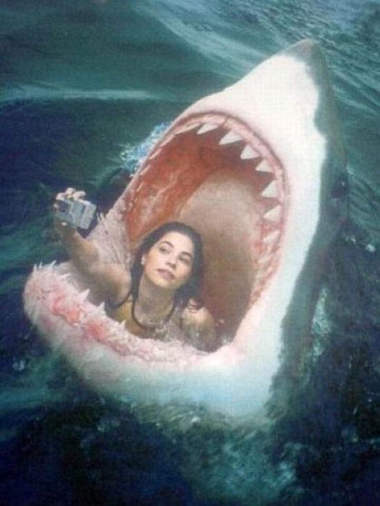 girl in shark's mouth selfie