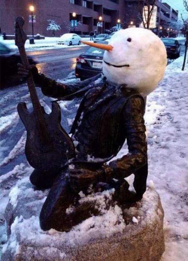 Cool snowman head guitar rocker street statue